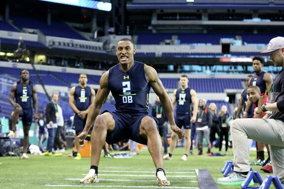 Utah defensive back Brian Allen competes in the broad jump at the 2017 NFL football scouting combine Monday, March 6, 2017, in Indianapolis. (AP Photo/Gregory Payan)