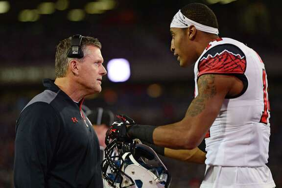 TUCSON, AZ - NOVEMBER 14: Defensive back Brian Allen #14 of the Utah Utes talks with head coach Kyle Whittingham on the sidelines in the game against the Arizona Wildcats at Arizona Stadium on November 14, 2015 in Tucson, Arizona. The Wildcats defeated the Utes 37-30 in double overtime. (Photo by Jennifer Stewart/Getty Images)