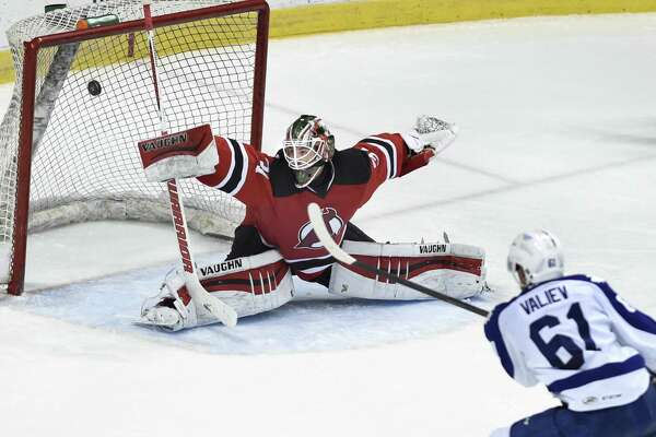 Devils' goaltender Scott Wedgewood makes a save during Game 5 of the American Hockey League quarterfinal playoff series against the Marlies on Thursday, May 12, 2016, at Times Union Center in Albany, N.Y. (Cindy Schultz / Times Union) ORG XMIT: MER2016101117224996