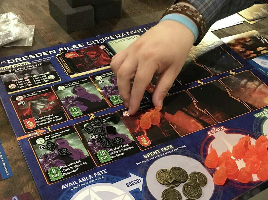 Knight Watch Games lets customers play  titles for free, such as The Dresden Files Cooperative Card Game (above). Photo: René A. Guzman /San Antonio Express-News