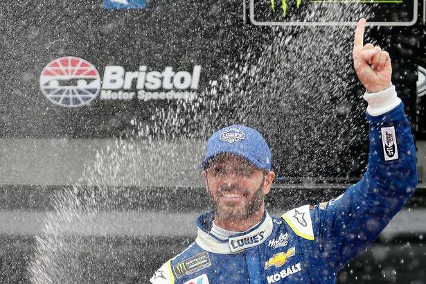 BRISTOL, TN - APRIL 24:  Jimmie Johnson, driver of the #48 Lowe's Chevrolet, celebrates after winning the Monster Energy NASCAR Cup Series Food City 500 at Bristol Motor Speedway on April 24, 2017 in Bristol, Tennessee.  (Photo by Matt Sullivan/Getty Images)