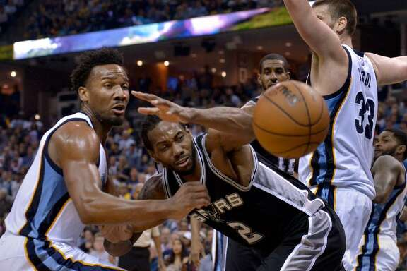 San Antonio Spurs forward Kawhi Leonard (2) loses control of the ball while defended by Memphis Grizzlies guard Wayne Selden Jr., left, and center Marc Gasol (33) during the second half of Game 4 in an NBA basketball first-round playoff series Saturday, April 22, 2017, in Memphis, Tenn.