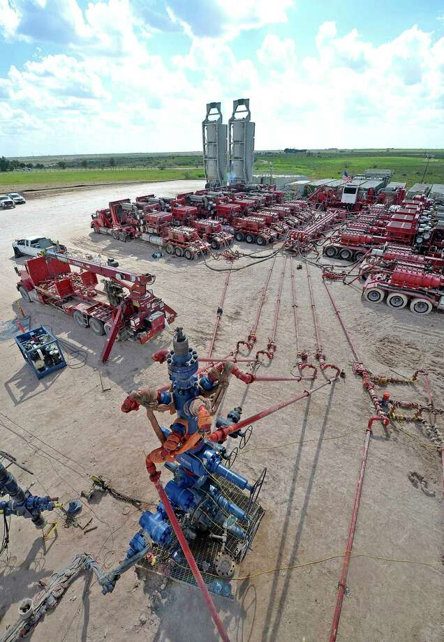 Aerial view of a fracking wellhead powered by a series of Halliburton pumping units at a fracking site managed by Octane Energy on Friday, Sept. 23, 2016 near Stanton. James Durbin/Reporter-Telegram Photo: James Durbin / © 2016 Midland Reporter Telegram. All Rights Reserved.