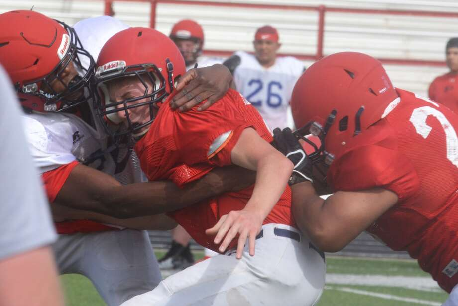 The Plainview football team hit the ground running and play got physical very quickly as the Bulldogs opened their spring football campaign Monday afternoon at Greg Sherwood Memorial Bulldog Stadium. Photo: Skip Leon/Plainview Herald
