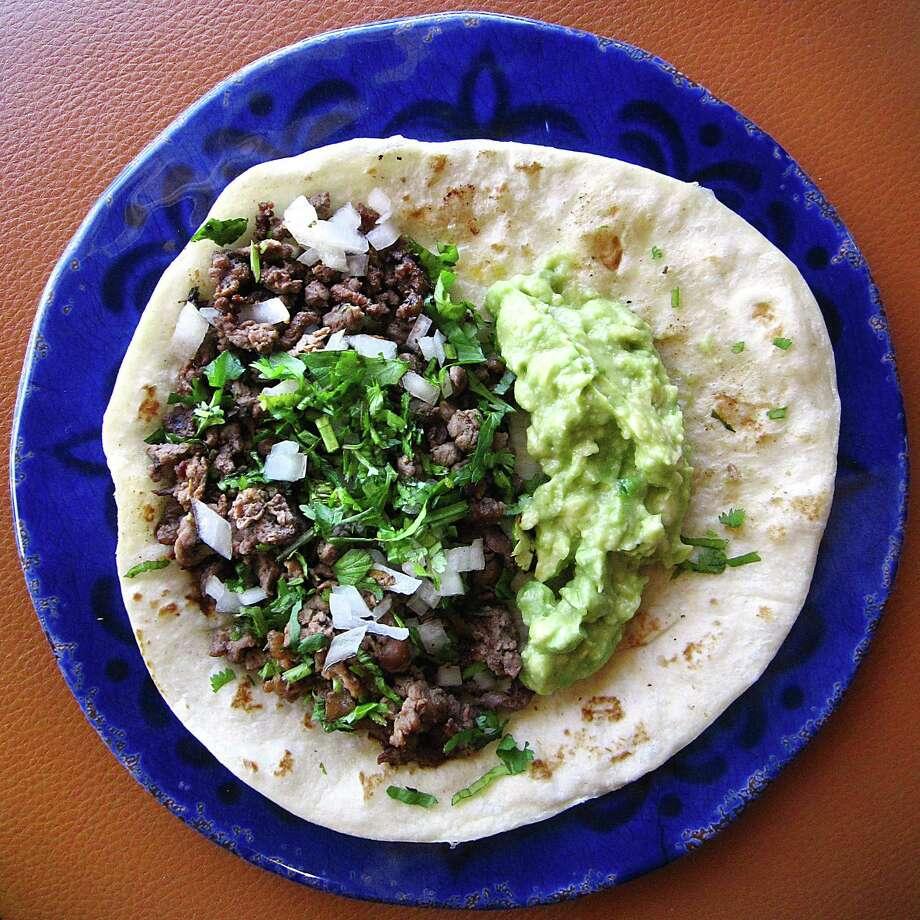 Carne asada and guacamole taco on a handmade flour tortilla from Hacienda Real. Photo: Mike Sutter /San Antonio Express-News