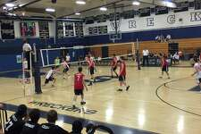 Players from Staples and Fairfield Warde during the volleyball match Monday. Staples defeated the Mustangs in three straight sets
