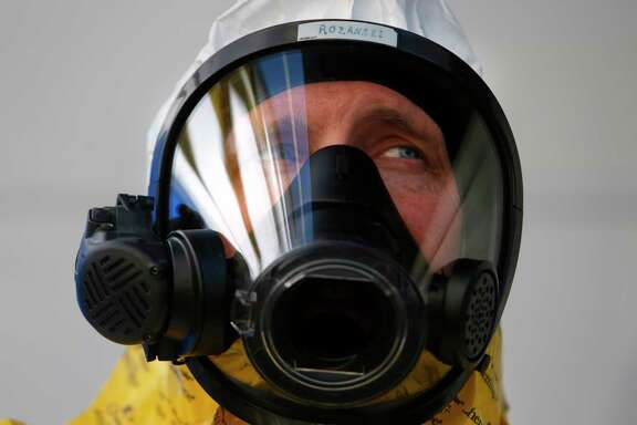 Tom Rozanski awaits instruction after suiting up in a hazmat suit during a drill on Monday, April 24, 2017, in Houston. AT&T's Network Disaster Relief team paired with the Houston Fire Department to simulate a contaminant exposure disaster. (Annie Mulligan / Freelance)