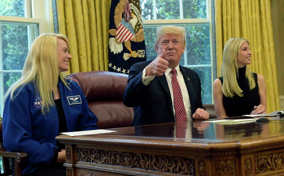 President Donald Trump, flanked by NASA astronaut Kate Rubins, left, and his daughter Ivanka Trump, gives a thumbs up following a video conference with the International Space Station, Monday, April 24, 2017, from the Oval Office of the White House in Washington. (AP Photo/Susan Walsh) Photo: Susan Walsh, STF / Copyright 2017 The Associated Press. All rights reserved.