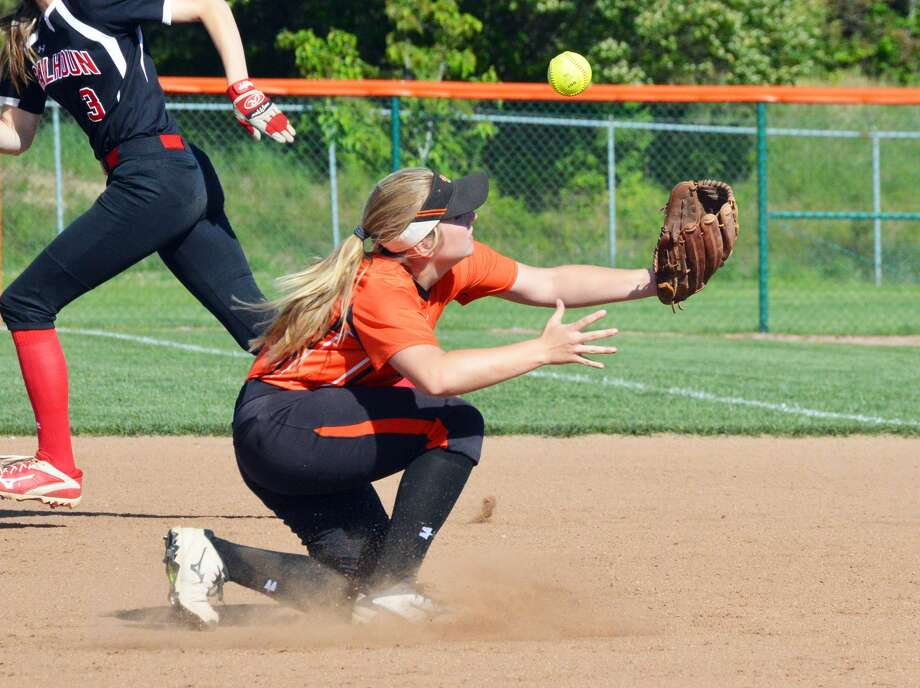 Edwardsville second baseman Emma Lewis knocks down a hard ground ball and gets a force out.