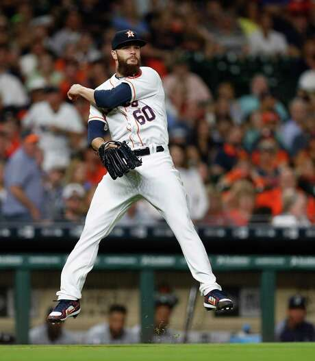 Dallas Keuchel fields one of the many grounders he's induced while beginning the season 3-0 heading into Tuesday's start at Cleveland. Photo: Karen Warren, Staff Photographer / 2017 Houston Chronicle