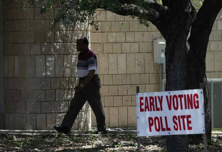 A voter arrives at the polling site at Brook Hollow Library on April 24. Early voting continues through May 2, except for April 28 and 30, when the polls are closed. The election is May 6. Photo: Jerry Lara /San Antonio Express-News / © 2017 San Antonio Express-News