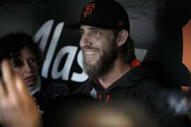 Madison Bumgarner (40) smiles as he answers questions from the press during batting practice before the San Francisco Giants played the Los Angeles Dodgers at AT&T Park in San Francisco, Calif., on Monday, April 24, 2017.