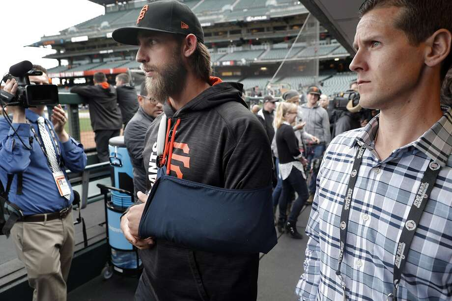 Madison Bumgarner (40) walks back to the locker room after he answered questions from the press during batting practice before the San Francisco Giants played the Los Angeles Dodgers at AT&T Park in San Francisco, Calif., on Monday, April 24, 2017. Photo: Carlos Avila Gonzalez, The Chronicle