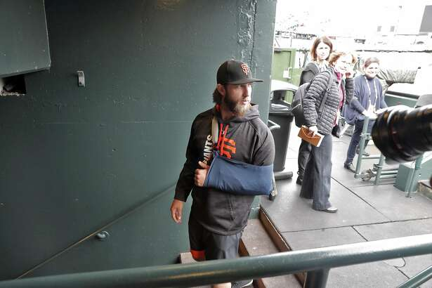 Madison Bumgarner (40) walks back to the locker room after he answered questions from the press during batting practice before the San Francisco Giants played the Los Angeles Dodgers at AT&T Park in San Francisco, Calif., on Monday, April 24, 2017.