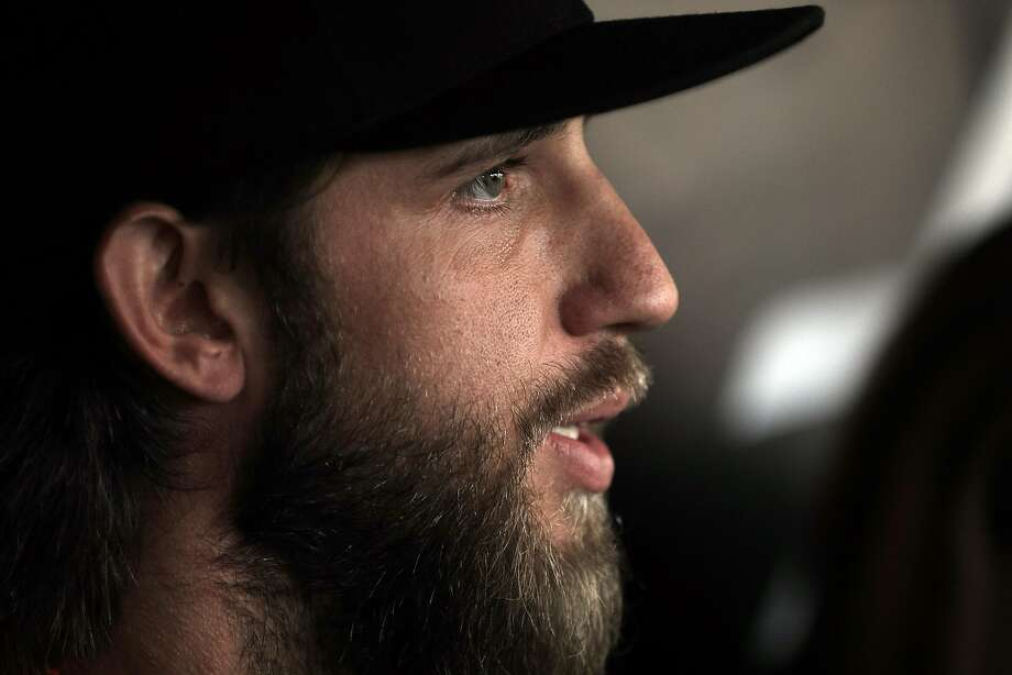 Madison Bumgarner (40) answers questions from the press during batting practice before the San Francisco Giants played the Los Angeles Dodgers at AT&T Park in San Francisco, Calif., on Monday, April 24, 2017. Photo: Carlos Avila Gonzalez / The Chronicle