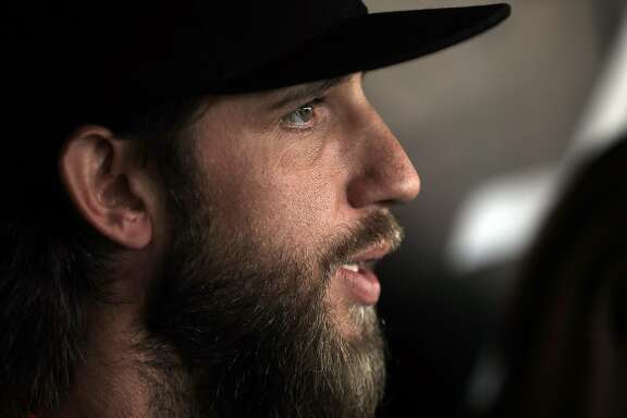 Madison Bumgarner (40) answers questions from the press during batting practice before the San Francisco Giants played the Los Angeles Dodgers at AT&T Park in San Francisco, Calif., on Monday, April 24, 2017.