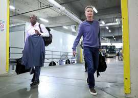 Golden State Warriors' interim head coach Mike Brown and head coach Steve Kerr arrive before playing Portland Trail Blazers in Game 4 of NBA Western Conference 1st Round Playoffs at Moda Center in Portland, Oregon on Monday, April 24, 2017.