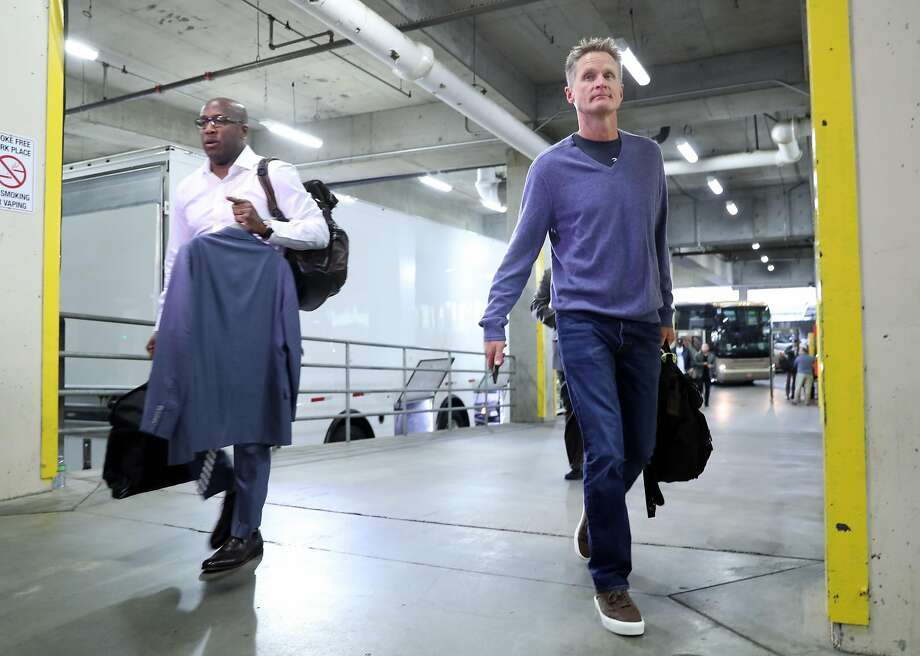 Golden State Warriors' interim head coach Mike Brown and head coach Steve Kerr arrive before playing Portland Trail Blazers in Game 4 of NBA Western Conference 1st Round Playoffs at Moda Center in Portland, Oregon on Monday, April 24, 2017. Photo: Scott Strazzante, The Chronicle