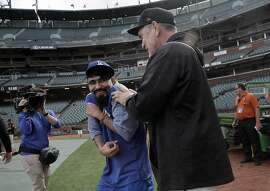 Giants Manager Bruce Bochy clowns around with Sergio Romo during batting practice before the San Francisco Giants played the Los Angeles Dodgers at AT&T Park in San Francisco, Calif., on Monday, April 24, 2017.