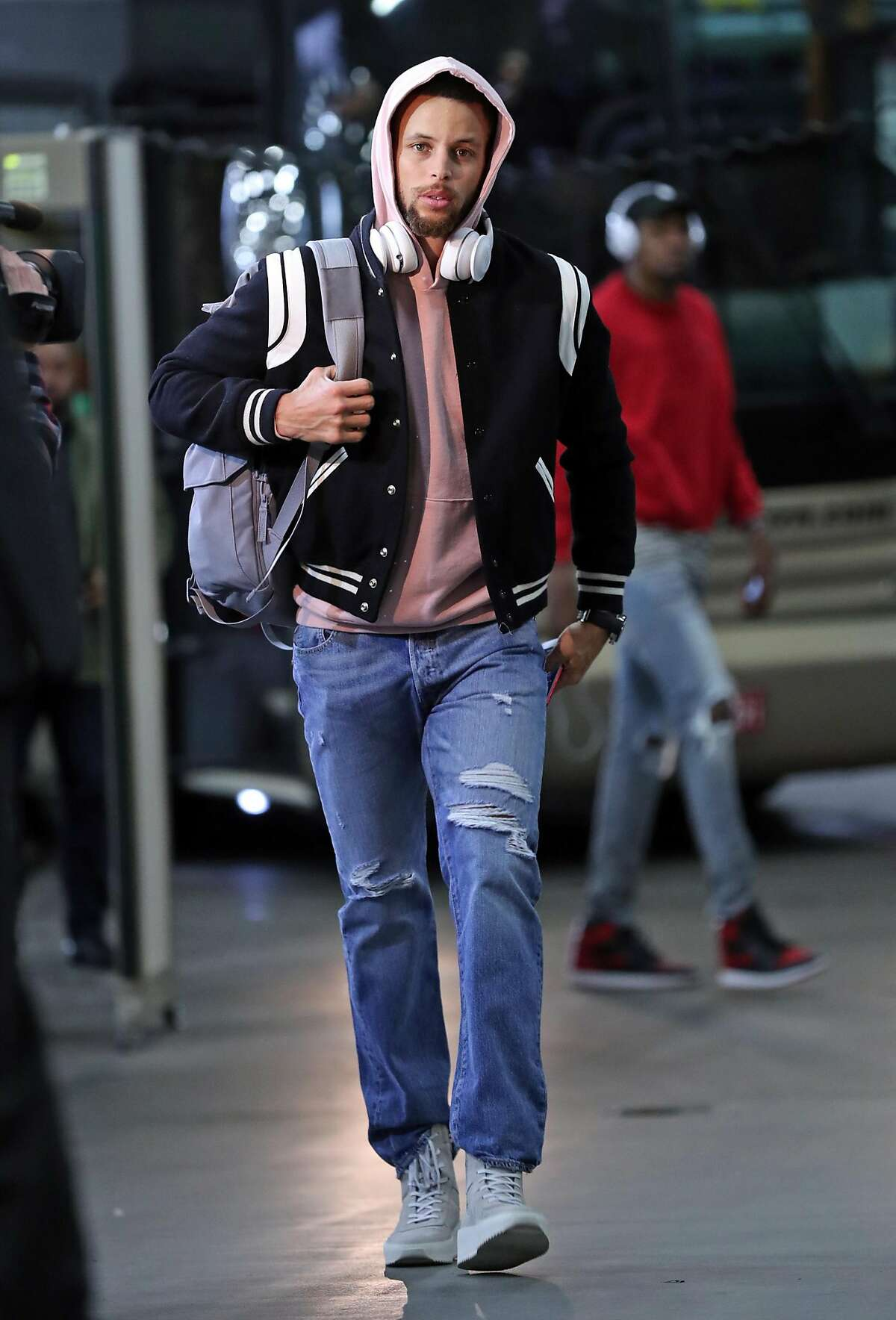 Express poster boy Stephen Curry goes for their signature trendy casual vibe, pairing a letterman-style jacket with a pink hoodie.