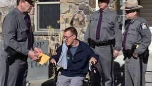Brock Hathaway, 19, of Copake participates in a ride-along at the State Police's Livingston barracks. Hathaway, who has cerebral palsy, collects patches from all law enforcement agencies and fire departments.  Lt. Eugene Hallenbeck presented Brock with a State Police Centennial T-shirt, patch and Troop K Challenge Coin. Any police or fire agencies with shoulder patches they would like to donate to Brock can mail them to: Brock Hathaway C/O the New York State Police - Livingston, 3353 Route 9, Hudson, New York, 12534.