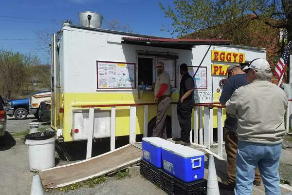 Customers line up Monday at Eggy's Place, a food truck at Erie Boulevard and Lawrence Street, near the old Central Warehouse north of downtown Albany. (Chris Churchill / Times Union)