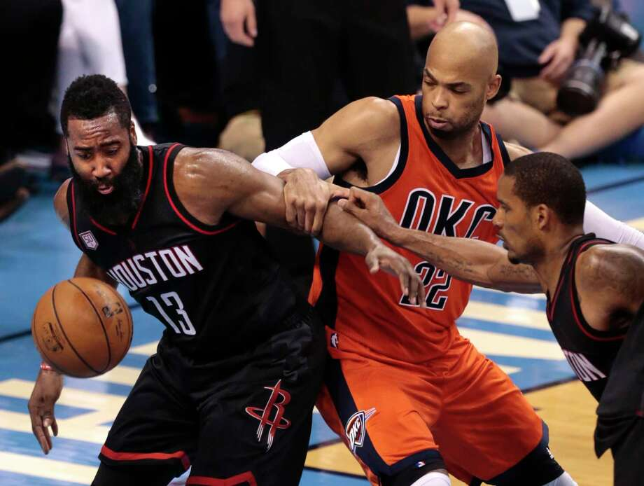 Guard James Harden, left, didn't shoot well Sunday (5-of-16) while playing on a sore ankle, but he did log 39 minutes and gave the Rockets eight assists and seven rebounds to go with his 16 points. Photo: Brett Coomer, Staff / © 2017 Houston Chronicle