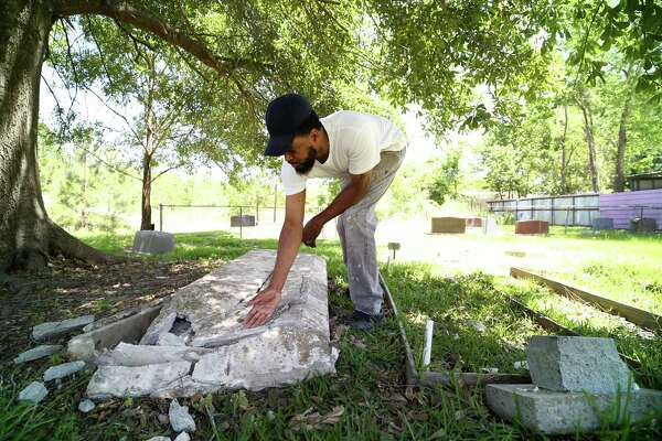 Rod Barnaba inspects the damage to a gravestone after someone drove through part of the historical Barrett Station Evergreen Cemetery over the weekend. The graves of Barnaba's family members were undisturbed.