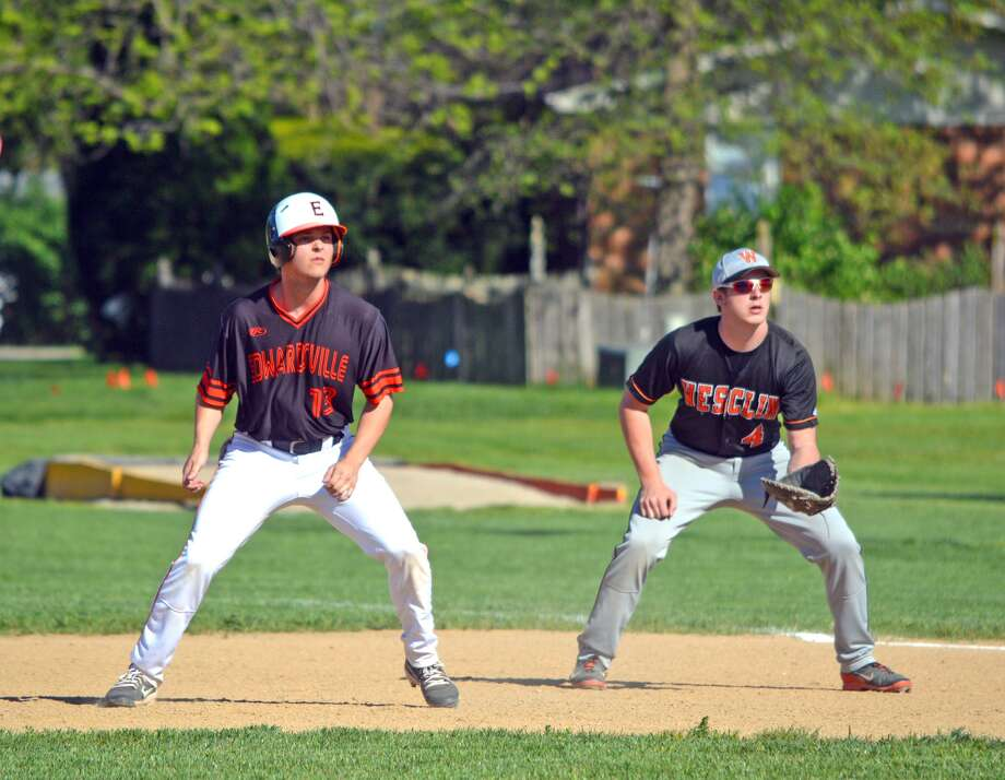Edwardsville senior Joel Quirin, left, leads off first base during the fifth inning of Monday's game at Trenton Wesclin.