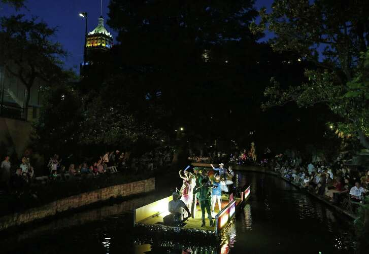 """The Children's Bereavement Center of South Texas float """"Kaleidoscope of Rainbow"""" makes its way to the Arneson River Theatre at La Villita during the 2017 Texas Cavaliers River Parade """" Kaleidoscope"""" held Monday April, 24, 2017."""
