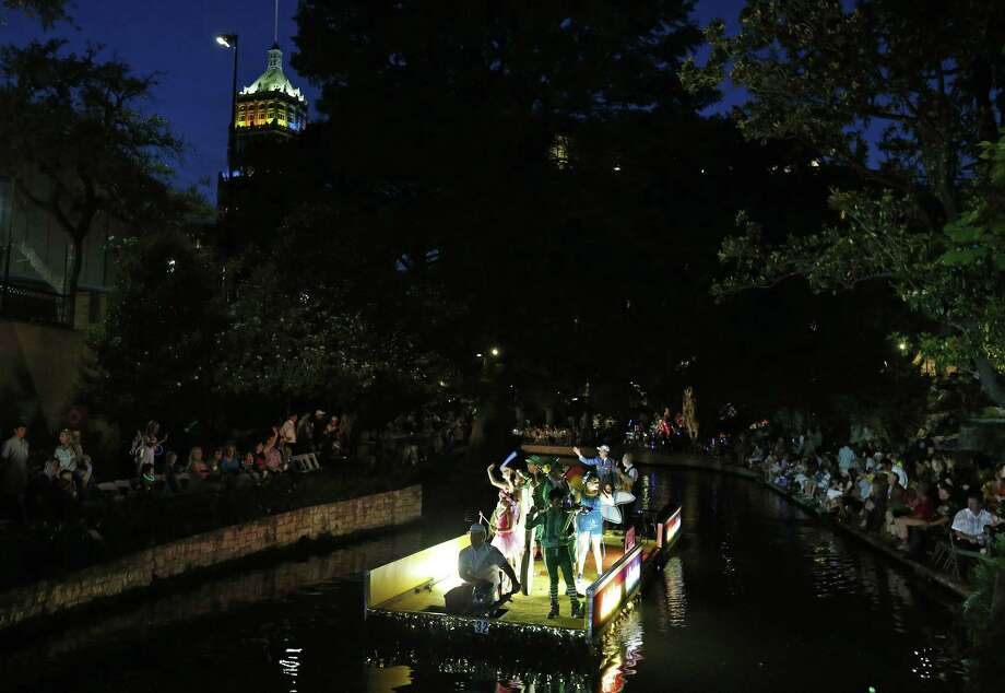 """The Children's Bereavement Center of South Texas float """"Kaleidoscope of Rainbow"""" makes its way to the Arneson River Theatre at La Villita during the 2017 Texas Cavaliers River Parade """" Kaleidoscope"""" held Monday April, 24, 2017. Photo: Edward A. Ornelas, Staff / San Antonio Express-News / © 2017 San Antonio Express-News"""