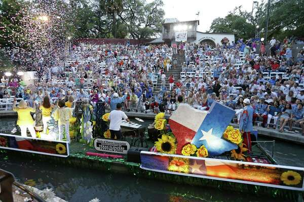 """The Battle of Flowers Association float """"Kaleidoscope of Texas Flowers"""" makes its way through the Arneson River Theatre at La Villita during the 2017 Texas Cavaliers River Parade """" Kaleidoscope"""" held Monday April, 24, 2017."""