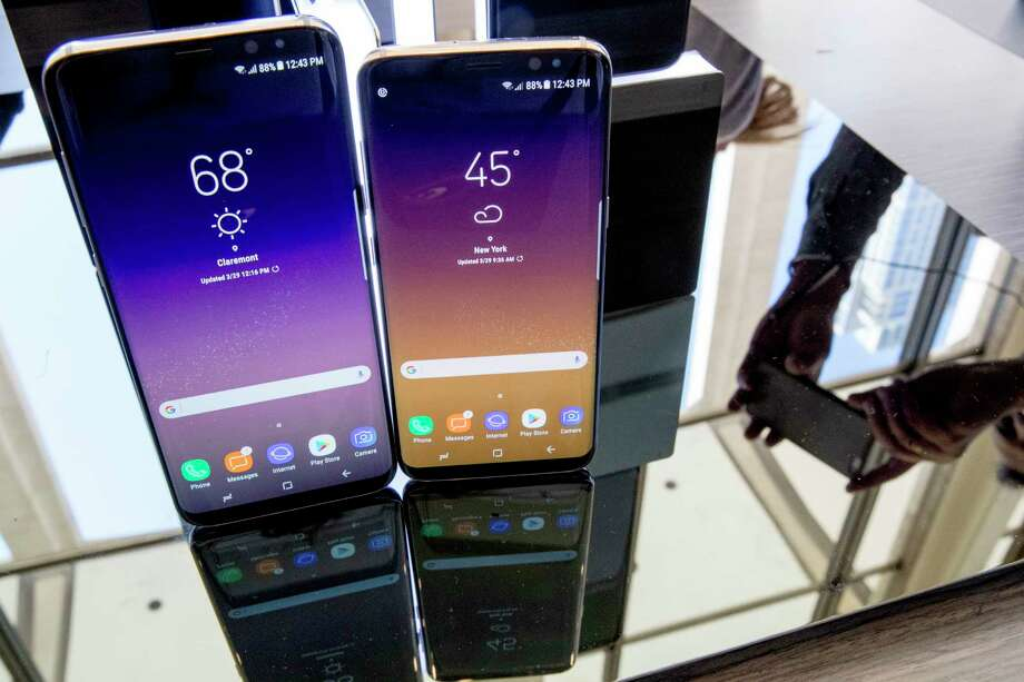 FILE - In this Wednesday, March 29, 2017, file photo, the Samsung Galaxy S8, right, and S8 Plus appear on display after a news conference, in New York. SquareTrade, a company that sells gadget-repair plans, says Samsung's latest phones, the Galaxy S8 and S8 Plus, are more prone to damage than earlier models due to their larger displays and high amount of glass. (AP Photo/Mary Altaffer, File) Photo: Mary Altaffer, STF / Copyright 2017 The Associated Press. All rights reserved.