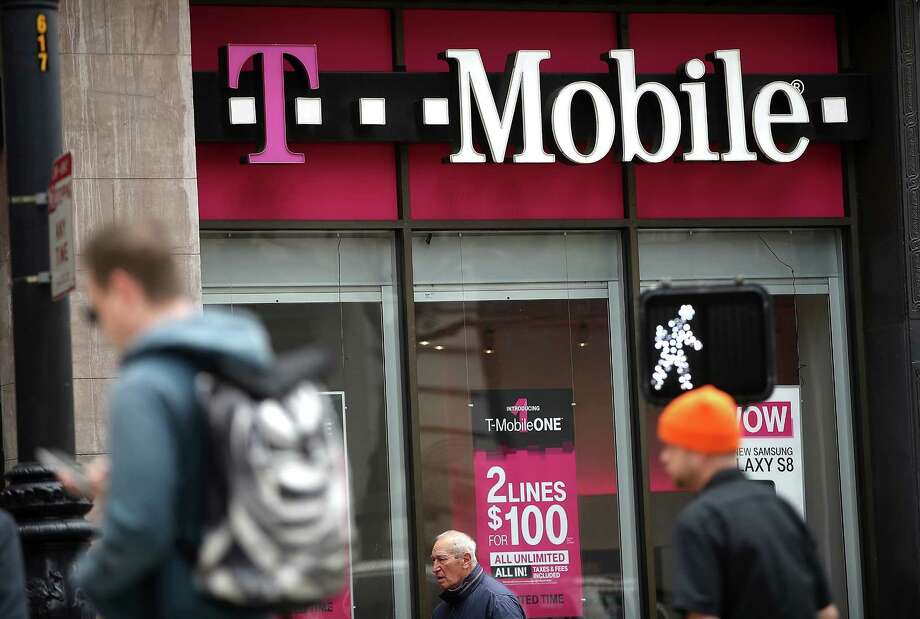 There is a great deal of pressure on Sprint to make a deal with T-Mobile, which operates this store in San Francisco. T-Mobile said Monday it will add 2.8 million to 3.5 million customers this year. Photo: Justin Sullivan, Staff / 2017 Getty Images