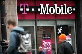 There is a great deal of pressure on Sprint to make a deal with T-Mobile, which operates this store in San Francisco. T-Mobile said Monday it will add 2.8 million to 3.5 million customers this year.