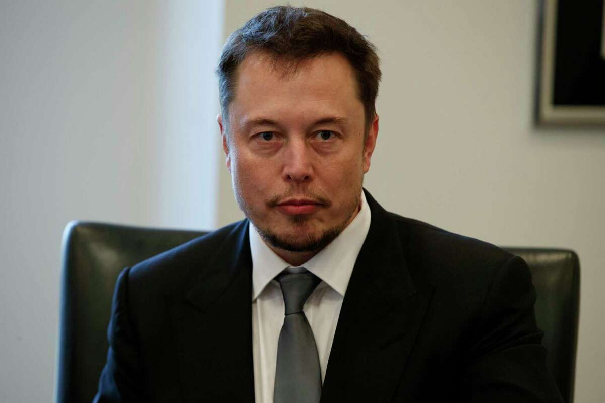 FILE - In this Dec. 14, 2016, file photo, Tesla CEO Elon Musk listens as President-elect Donald Trump speaks during a meeting with technology industry leaders at Trump Tower in New York., Musk was spotted spending time with actress Amber Heard in Australia on April 24, 2017.