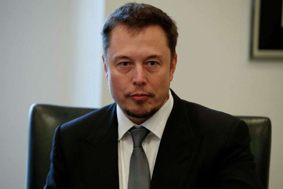 FILE - In this Dec. 14, 2016, file photo, Tesla CEO Elon Musk listens as President-elect Donald Trump speaks during a meeting with technology industry leaders at Trump Tower in New York., Musk was spotted spending time with actress Amber Heard in Australia on April 24, 2017.  Photo: Evan Vucci / Copyright 2016 The Associated Press. All rights reserved.