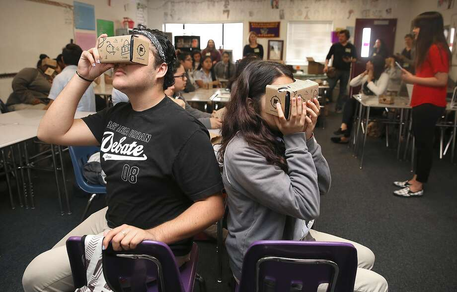 Oakland students Eduardo Venegas (left), 17, and Valeria Ochoa, 16, use Google Cardboard viewers to see virtual reality images of locations related to newly popular Alexander Hamilton, the first Treasury secretary. Photo: Liz Hafalia, The Chronicle
