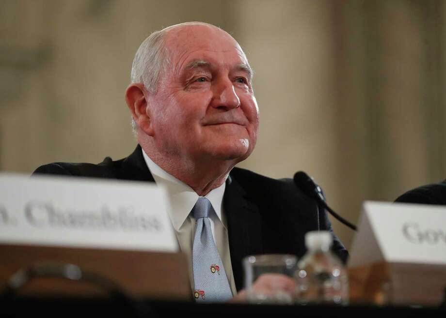 FILE - In this March 23, 2017 file photo, Agriculture Secretary-designate, former Georgia Gov. Sonny Perdue arrives to testify on Capitol Hill in Washington to testify at his confirmation hearing before the Senate Agriculture, Nutrition and Forestry Committee. After months of delays, the Senate is expected to confirm Agriculture Secretary nominee Sonny Perdue on Monday, April 24, 2017, with bipartisan support. (AP Photo/Pablo Martinez Monsivais, File) Photo: Pablo Martinez Monsivais, STF / Copyright 2017 The Associated Press. All rights reserved.
