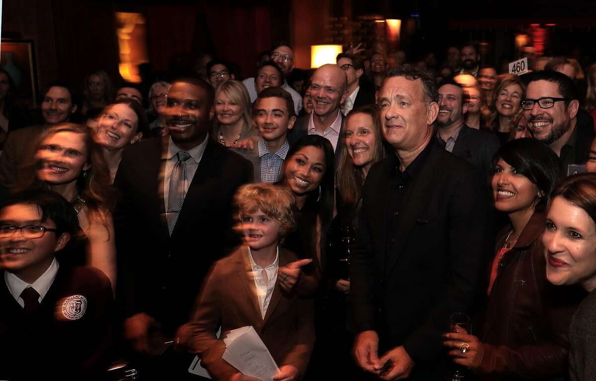 Special guest Tom Hanks joins guests for a photograph after reading from his new book Uncommon Type: Some Stories, during a fundraiser to benefit 826 Valencia and ScholarMatch, at Bimbo's 365 Club in San Francisco, Calif., on Monday April 24, 2017.