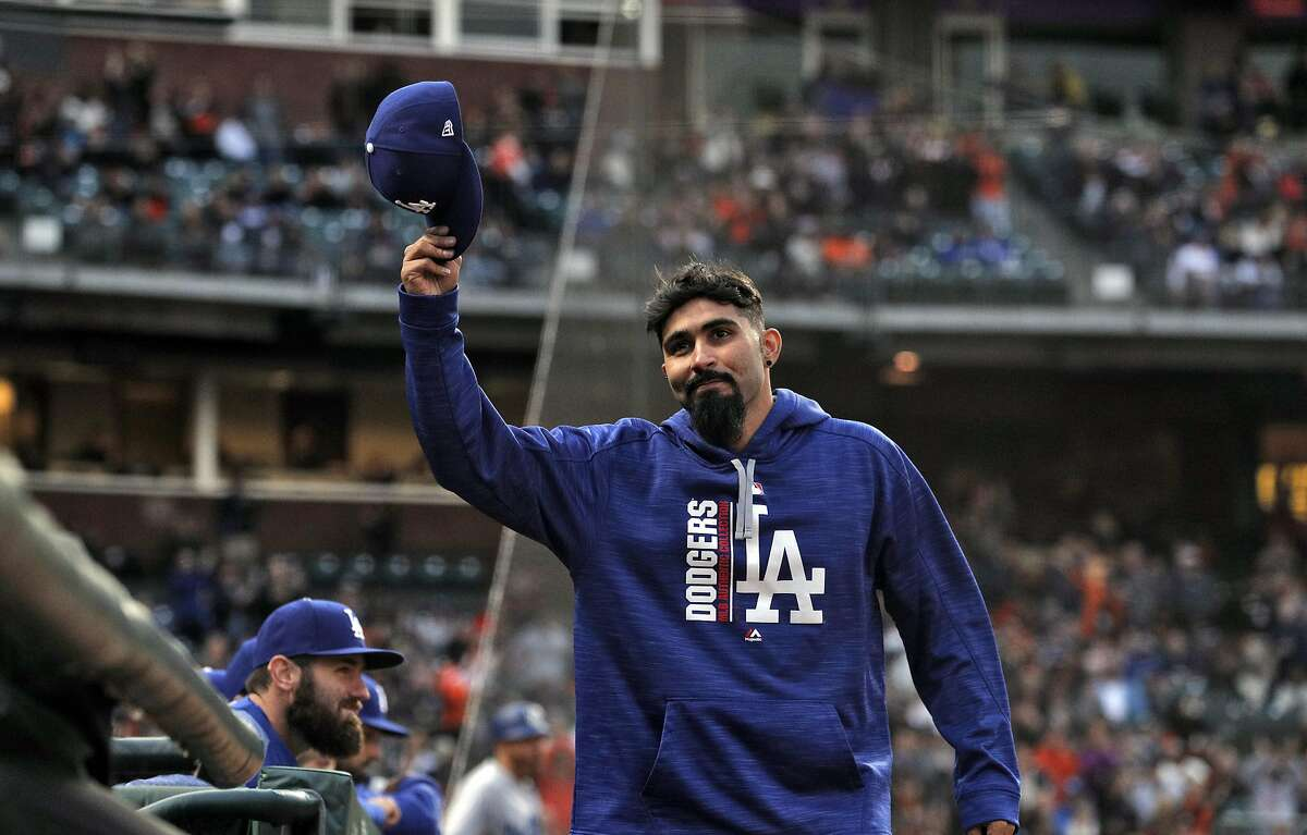 Sergio Romo (54) tips his hat to the crowd after the Giants took a moment to commemorate his time with the Giants on the bideo scoreboard as the San Francisco Giants played the Los Angeles Dodgers at AT&T Park in San Francisco, Calif., on Monday, April 24, 2017.