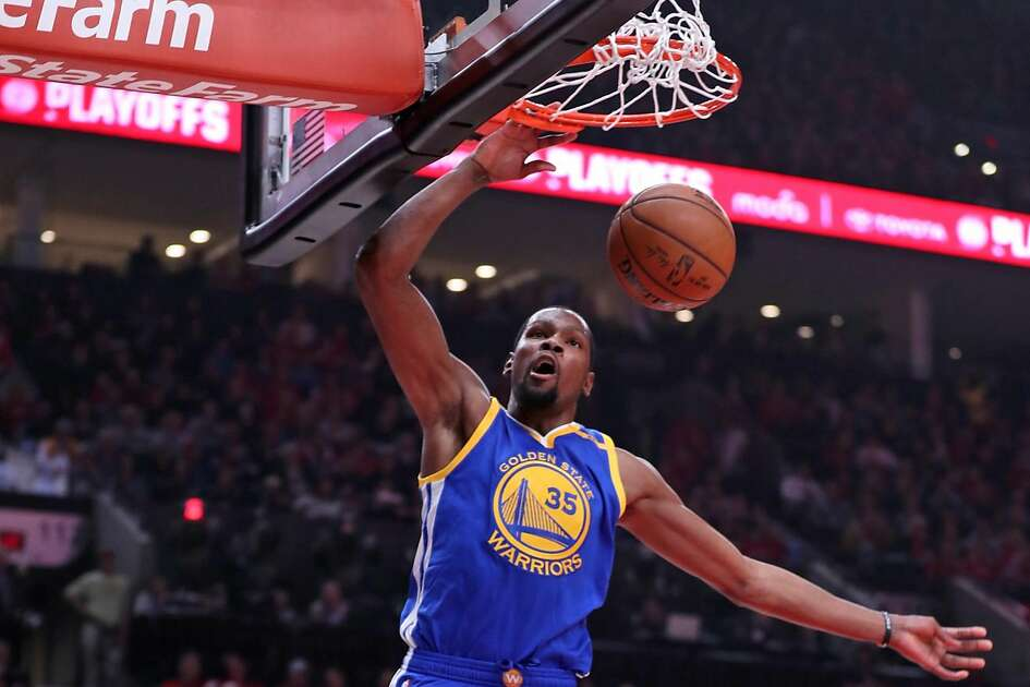 Golden State Warriors' Kevin Durant dunks against Portland Trail Blazers in 1st quarter in Game 4 of NBA Western Conference 1st Round Playoffs at Moda Center in Portland, Oregon on Monday, April 24, 2017.