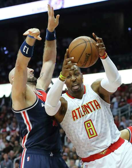 Atlanta's Dwight Howard beats Washington's Marcin Gortat for one of his 15 rebounds Monday night. Howard's double-double included 16 points. Photo: Curtis Compton, MBR / Atlanta Journal-Constitution