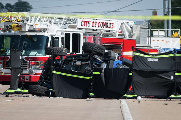 Law enforcement investigate the scene of a crash that resulted in four deaths on Sunday, Sept. 20, 2015, on Texas 105 and Marina Drive. Three other people involved in the crash were hospitalized with non-life threatening injuries.