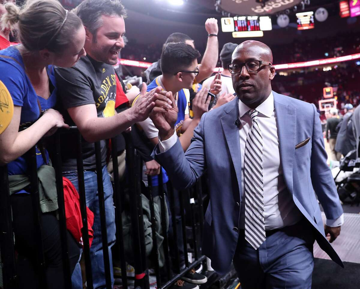Golden State Warriors' interim head coach Mike Brown greets fans after Warriors' 128-103 win over Portland Trail Blazers in Game 4 of NBA Western Conference 1st Round Playoffs at Moda Center in Portland, Oregon on Monday, April 24, 2017.