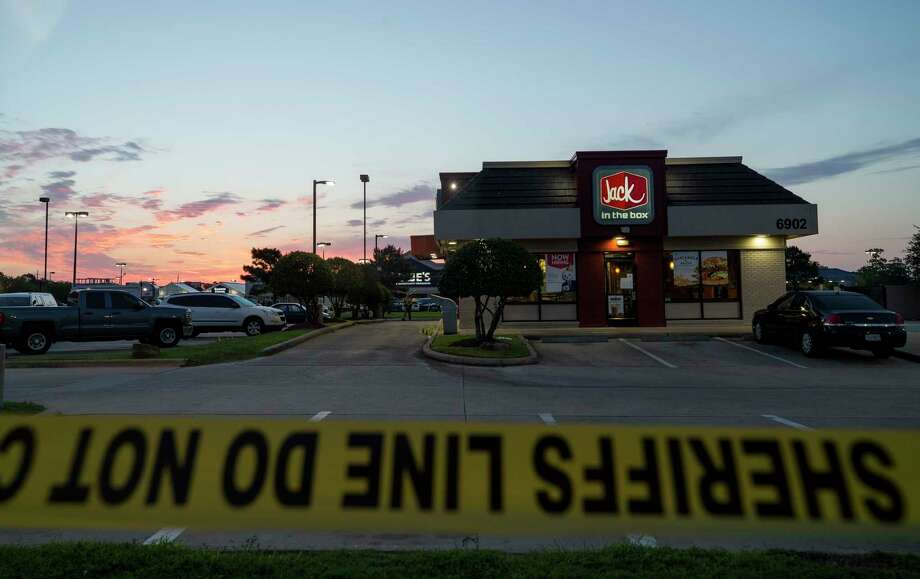 Authorities investigate the scene at 6902 North State Highway 6, where a multi-agency task force stopped an armed robbery, fatally shooting one of the suspected robbers and injuring two more late Monday night, in Houston. Photo: Godofredo A. Vasquez, Houston Chronicle / Godofredo A. Vasquez