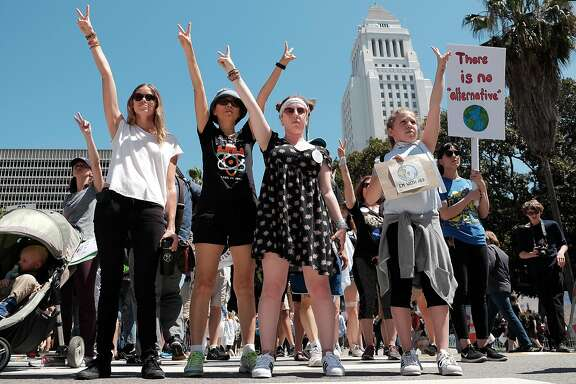 LOS ANGELES, CA - APRIL 22:  Women are seen demonstrating in front of a small pro-Trump counter demonstration as scientists and supporters participate in a March for Science on April 22, 2017 in Los Angeles, California. The event is being described as a call to support and safeguard the scientific community. (Photo by Sarah Morris/Getty Images)