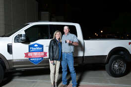 Wesley Campbell of Floydada, with wife Tracy, holds the keys to the 2016 One Ton Club truck, a Ford Super Duty F-350 King Ranch. He won use of the truck for two years in a drawing among FiberMax One Ton Club members.