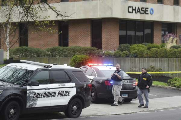 Police respond to an armed robbery at the Chase Bank on East Putnam Avenue in the Riverside section of Greenwich, Conn. the morning of Tuesday, April 25, 2017. Police say that the same person, described as a white male with a stocky build, also robbed the Cos Cob Citgo station Monday night around 10 p.m.