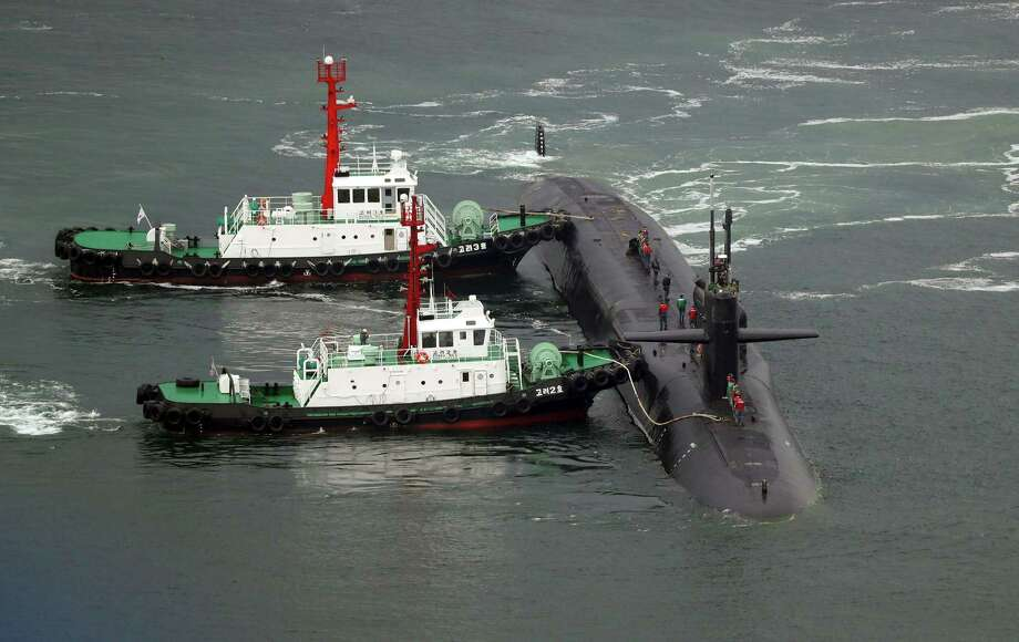 TOPSHOT - Nuclear-powered submarine USS Michigan approaches at the southeastern port city of Busan on April 25, 2017. North Korea on April 25, marked a military anniversary with a conventional firing drill, reports said, as South Korea announced joint naval exercises with a US aircraft carrier amid tensions over Pyongyang's nuclear ambitions. / AFP PHOTO / YONHAP / YONHAP /  - South Korea OUT / NO ARCHIVES -  RESTRICTED TO SUBSCRIPTION USEYONHAP/AFP/Getty Images Photo: YONHAP, Stringer / AFP/Getty Images / AFP